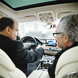 Ricky Hudi, head of electrics and electronics development Audi AG, demonstrating the navigation system of Audi A8 (photo)